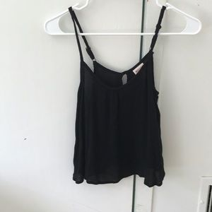 black flowy tank top with adjustable straps
